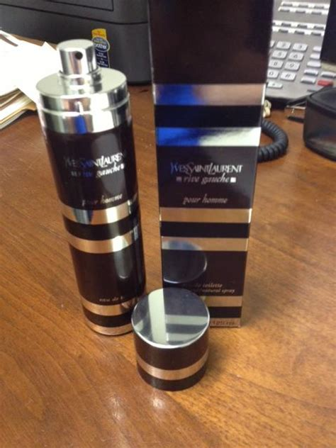 Ysl Rive Gauche Tin Can just received ysl rive gauche box and tin look brownish is it legit