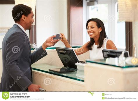 hotel front desk jobs nyc businessman checking in at hotel reception front desk