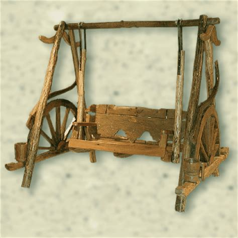 wagon wheel porch swing outdoor wagon wheel swing glider the american west