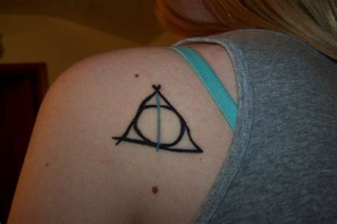 deathly hollows tattoo 5 deathly hallows tattoos contrariwise literary tattoos