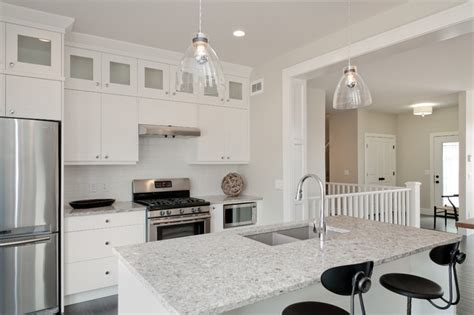 white kitchen cabinets with white countertops white kitchen cabinets with black quartz countertops