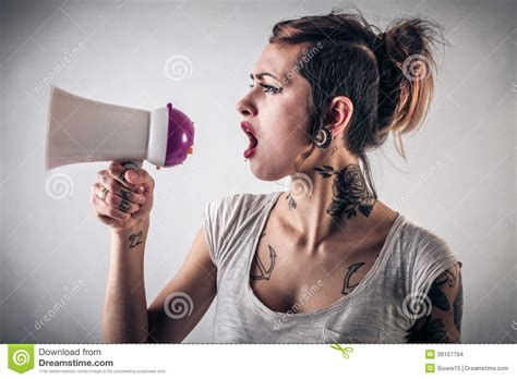 woman with tattoos with tattoos using a megaphone stock images image