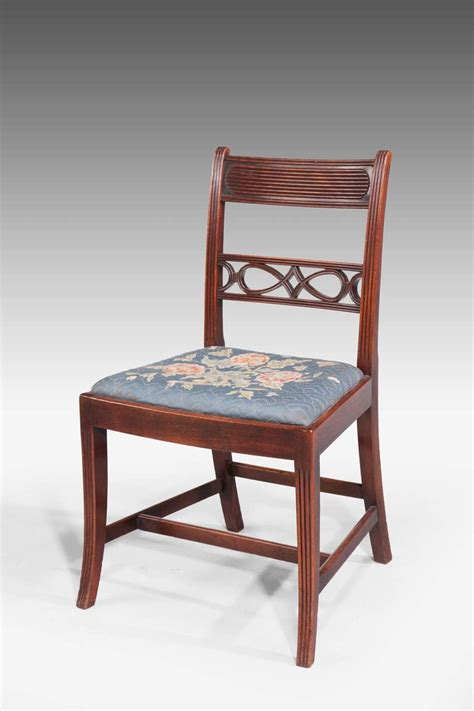 eight george iii period dining chairs with pierced splats