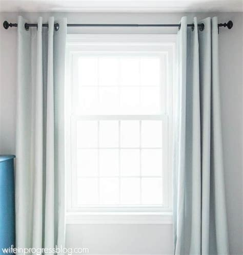 how high should curtain rods be above window how to hang curtains simple tips for a bigger and