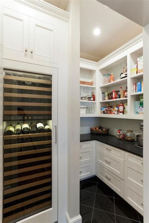 stunning pantry  tall integrated glass front wine