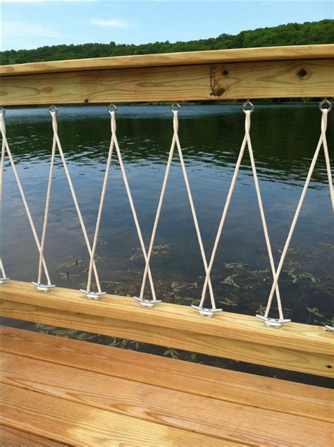 deck boat designs close up of deck railing with cleats and rope dock