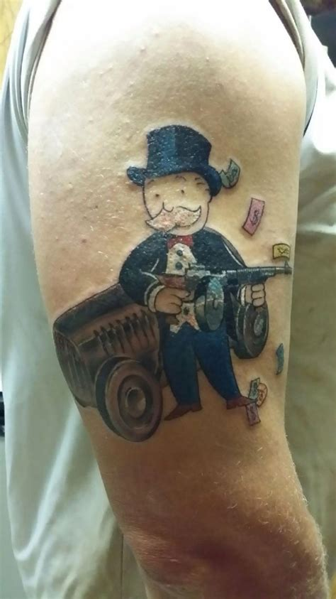 tommy gun tattoo monopoly gun start to a half sleeve