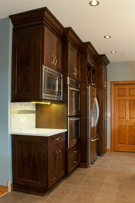 Blue Kitchen With Oak Cabinets mixing cabinet styles