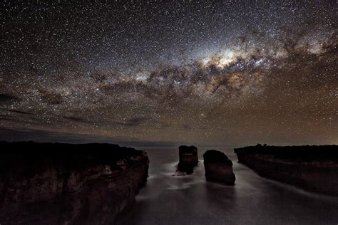 Light Up The Sky Band by A Milky Way Shadow At Loch Ard Gorge Earth Blog