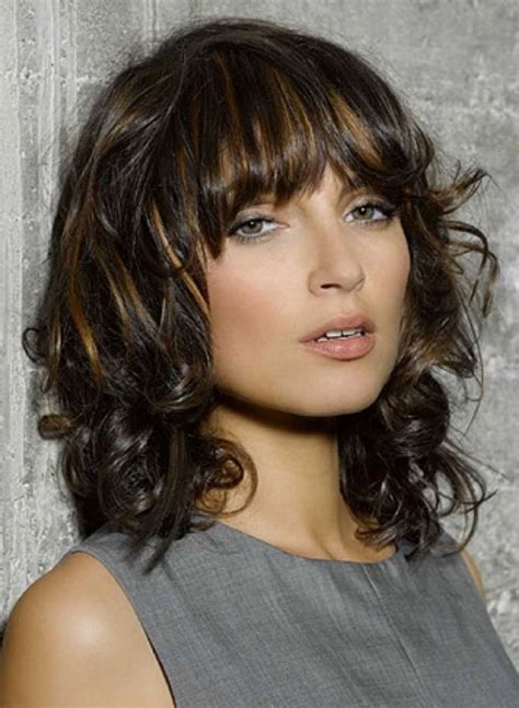 medium hairstyles heavy medium length hairstyles for thick wavy hair with bangs