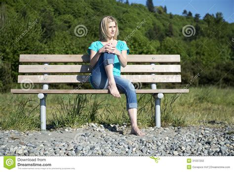 woman on bench woman on bench stock photography image 31037202