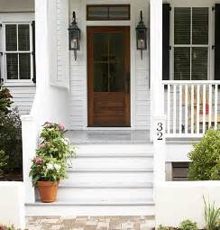 Be still my heart your wood front door and welcoming front porch