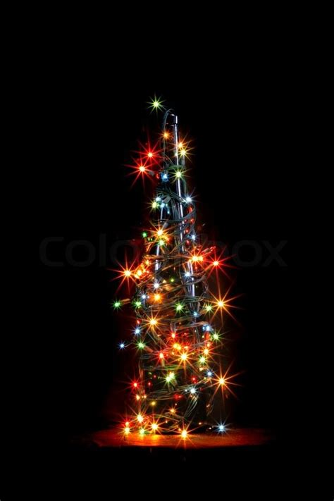 black colored christmas lights christmas alcohol bottle with color lights on black