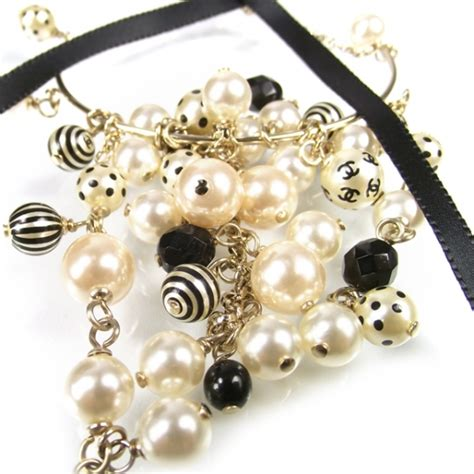 Black Pearl With Ribbon Earrings chanel cc pearl hoop ribbon earrings black white 19977