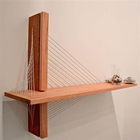 unique shelf that was inspired by suspension bridge