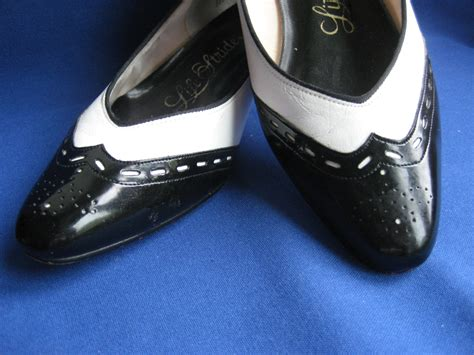 spectator shoes black and white flats vegan faux leather
