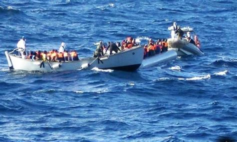 refugee boat italy spain 2 900 migrants saved in several sea rescue operations