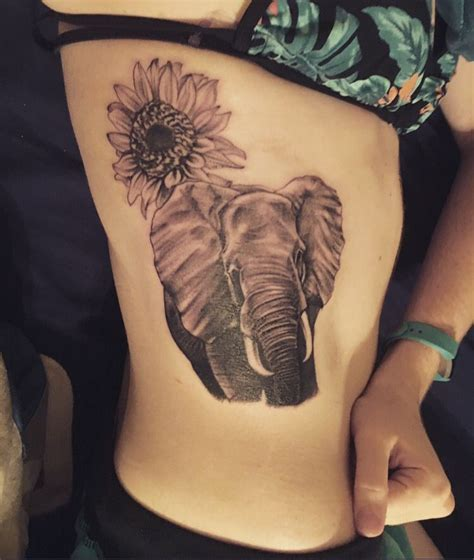 elephant tattoo with flowers elephant and rising sun flower inked