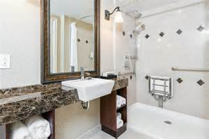 Seat in bathroom traditional with narrow sink next to small bathroom