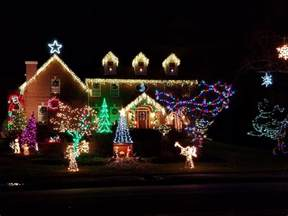 hanging outdoor christmas lights for the holidays