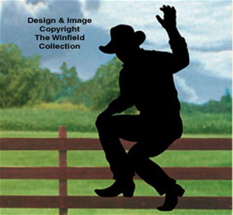 people waving cowboy fence shadow wood pattern
