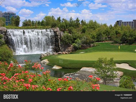 beautiful images beautiful golf course and waterfall stock photo stock