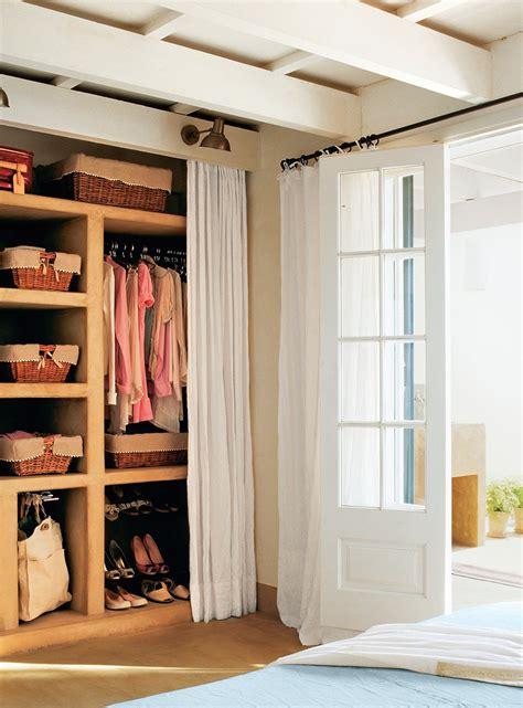 armarios con cortinas c 243 mo tener un armario m 225 s en casa