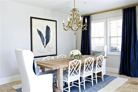 A Glamorous dining room in navy, white, and gold. ? STUDIO MCGEE