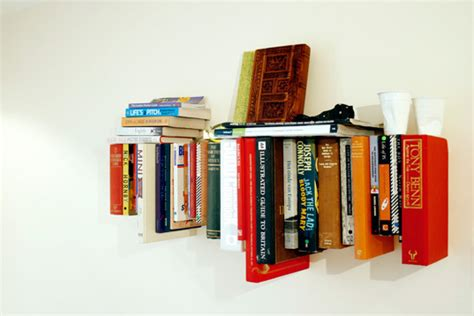 book shelf made from books inhabitat green design