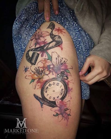 women tattoo thigh tattoo by abbie jago pocket watch