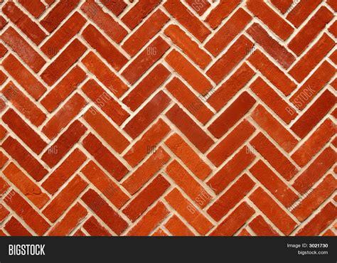 zigzag brick pattern abstract close up of a zigzag pattern red brick wall