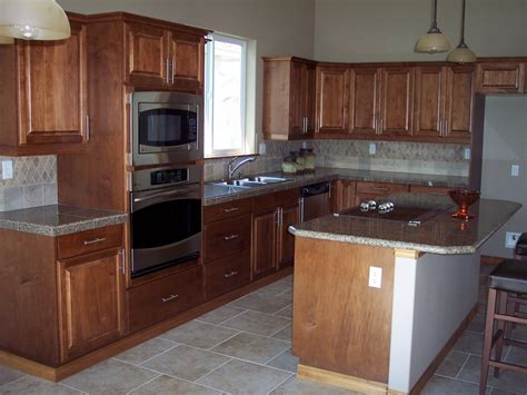 granite counter with wood cabinets granite
