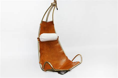 Leather and brass hanging chair