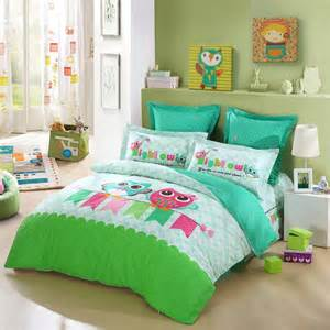 Lime green turquoise blue and pink cartoon night owl print jungle