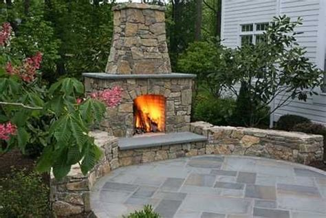 patio with outdoor fireplace natural stone around the