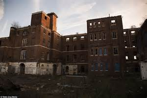 crossrail construction site hoardings undergo a make over decaying ruins are all that remain of the abandoned asylum