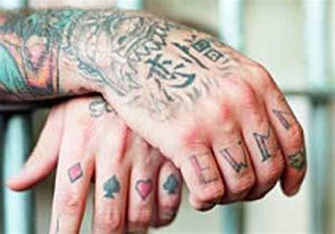 finger tattoo gang 15 prison tattoos and their meanings