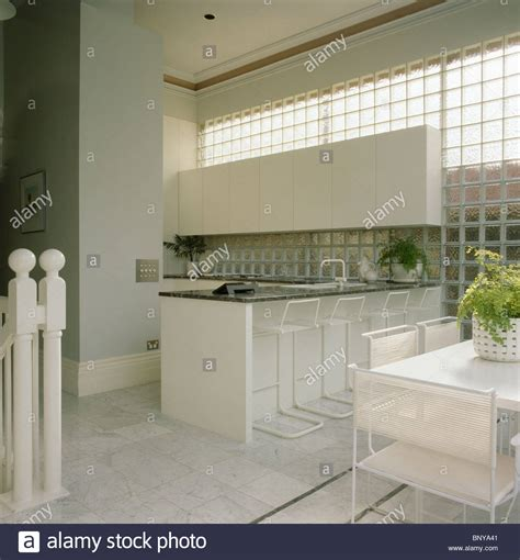 white modern kitchen breakfast bar island stools glass glass brick wall in modern kitchen dining room with white