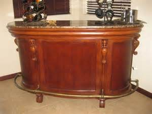 1 000 custom made bar w granite top and brass rails for