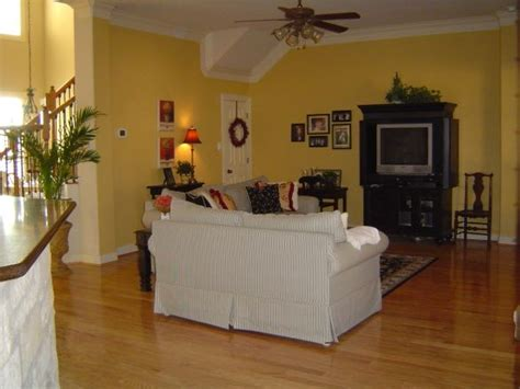 light yellow living room family room finished pale yellow walls with black cream