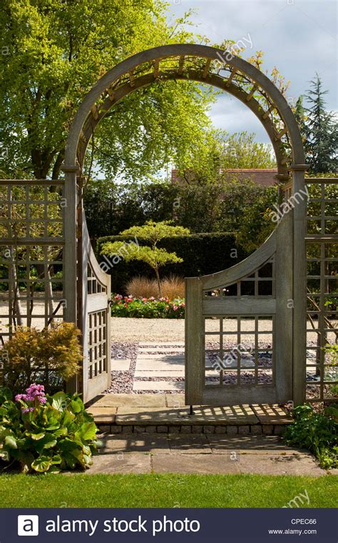 garden feature arch with gates leading into and