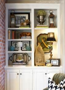 how to decorate built in shelves organizing and arranging bookshelves kara leigh interiors