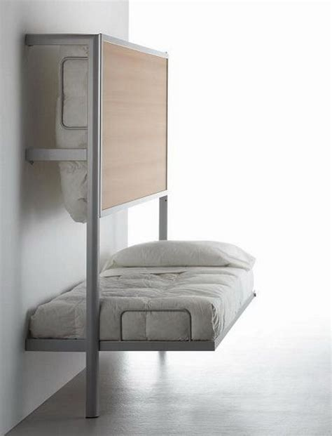 smart space saving bed hides a walk in closet underneath space saving beds for small apartments