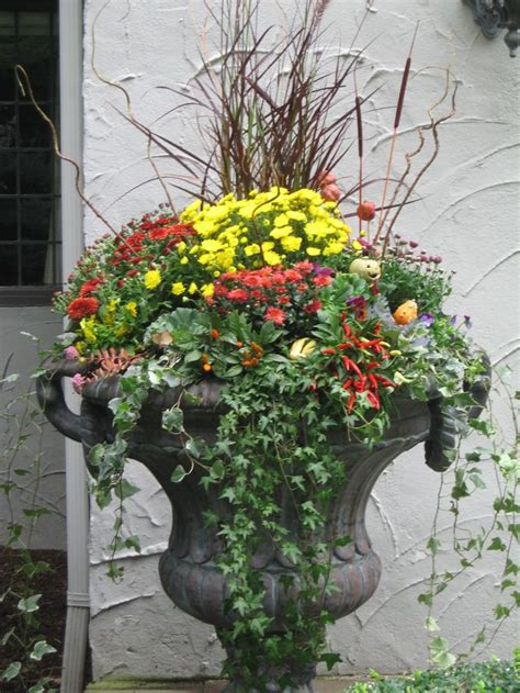 Flower Arrangements For Outside Planters by 17 Best Ideas About Fall Planters On Fall