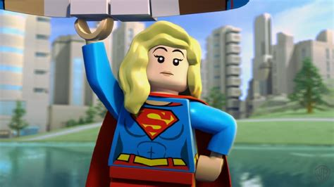 absolute justice league the world s greatest superheroes by alex ross paul dini new edition supergirl flies into in new dc lego heroes