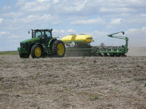 Planting Soybeans With Corn Planter by Farmers Busy Planting Future Farm Meets Fork