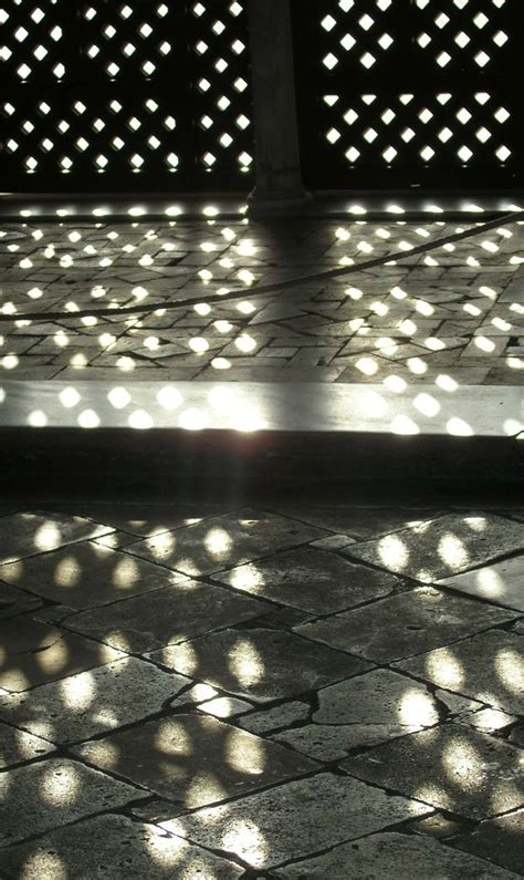 lights that cast patterns geometric patterns cast by shadows in spain photograph by