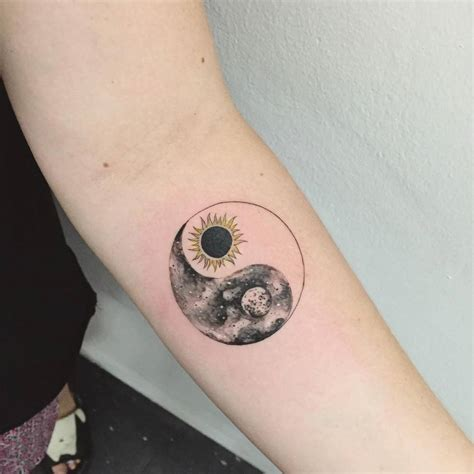 sun moon yin yang tattoo on the forearm tattoo artist