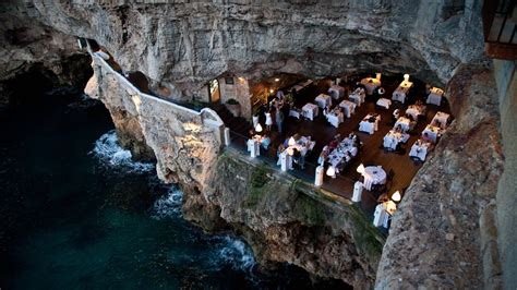cave resturuant side of a cliff italy 6 exotic restaurants that are really worth the flight