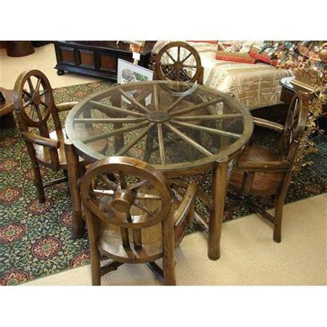 Wagon Wheel Table by Primitive Rustic Wagon Wheel Dining Table Chair 1988553